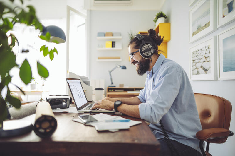 Young man with beard working from home